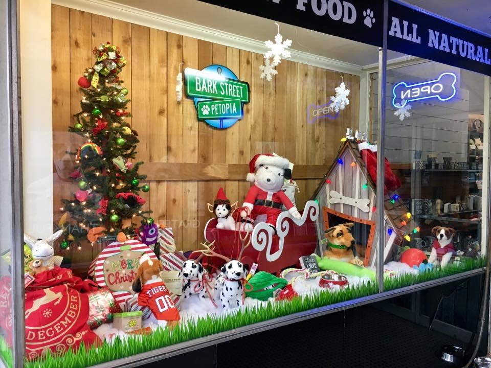 holiday window display at a pet shop